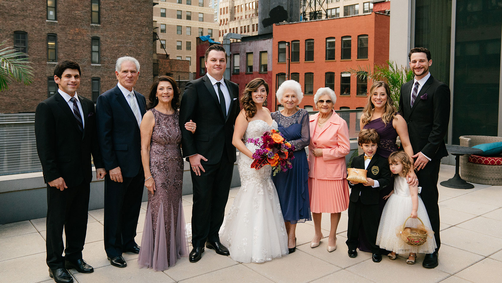 April and Daniel with family members on their wedding day