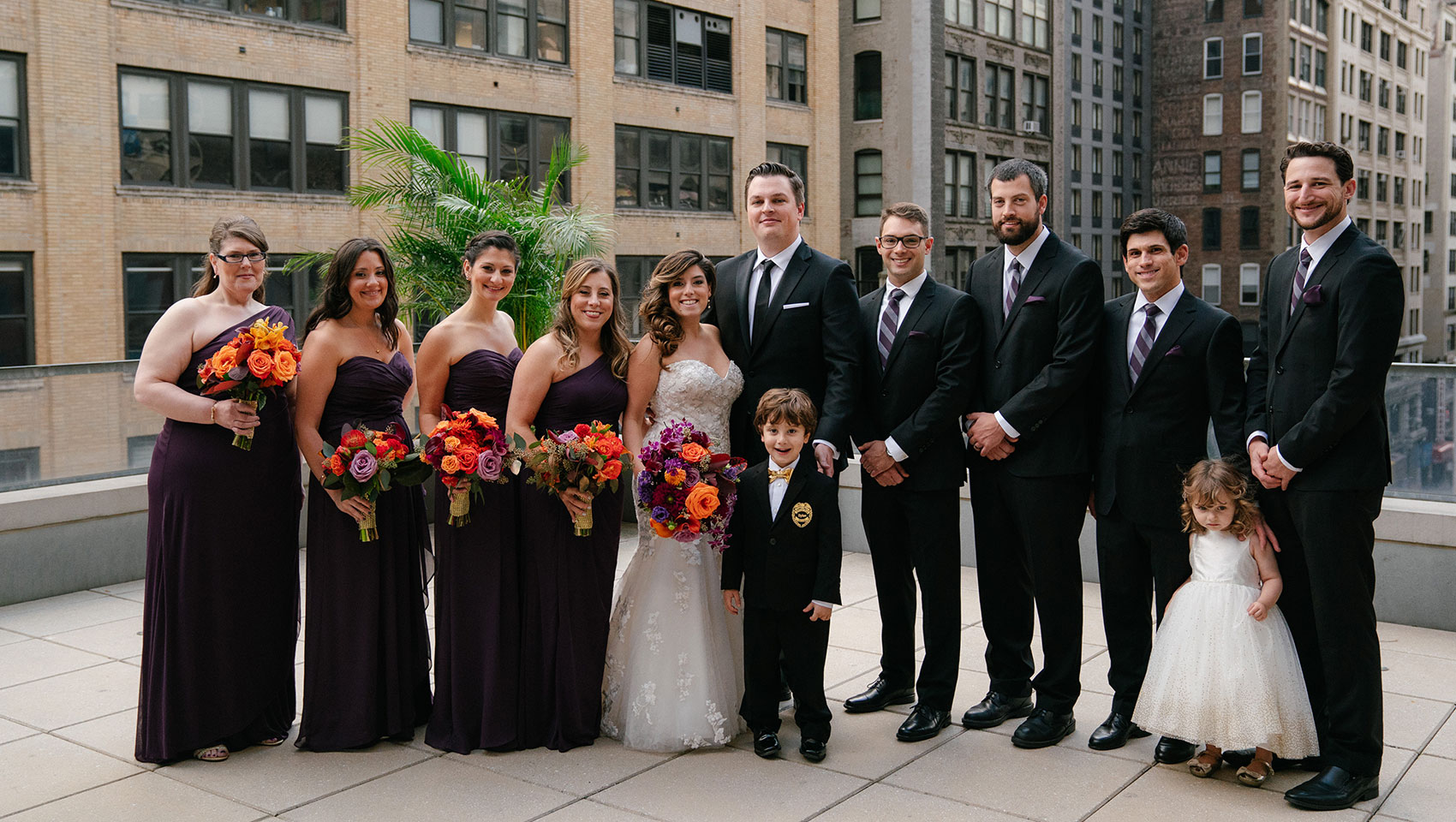 April and Daniel with their bridesmaids and groomsmen and two young children