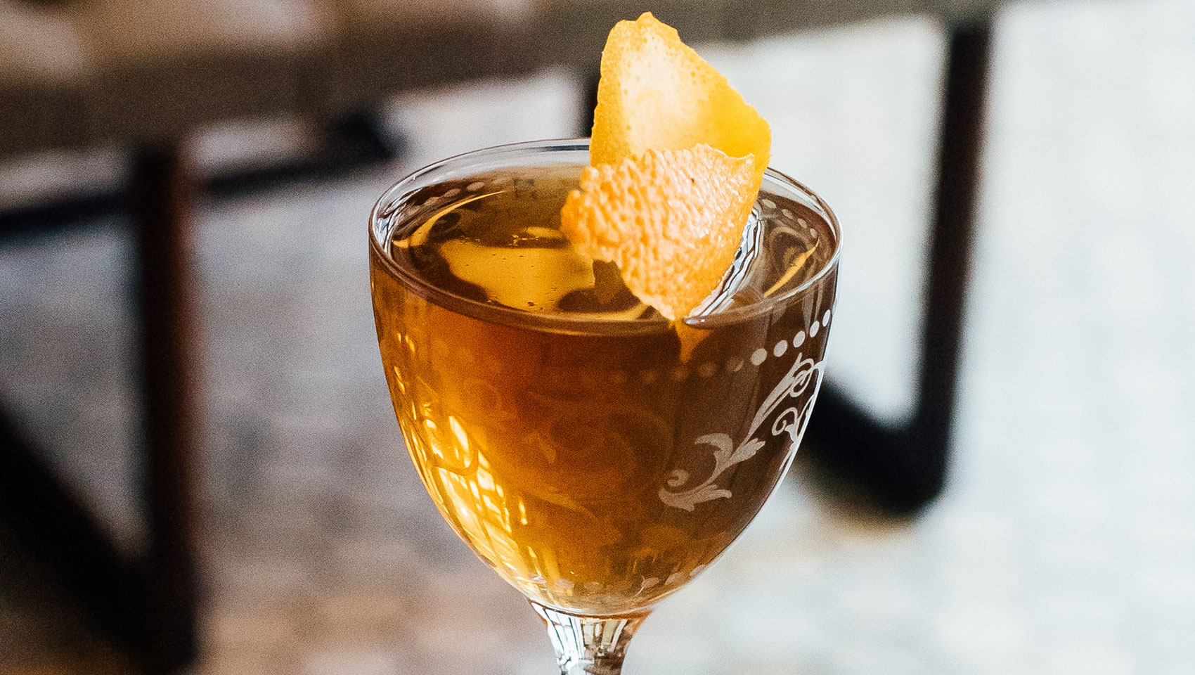 The Vine cocktail with orange peel garnish