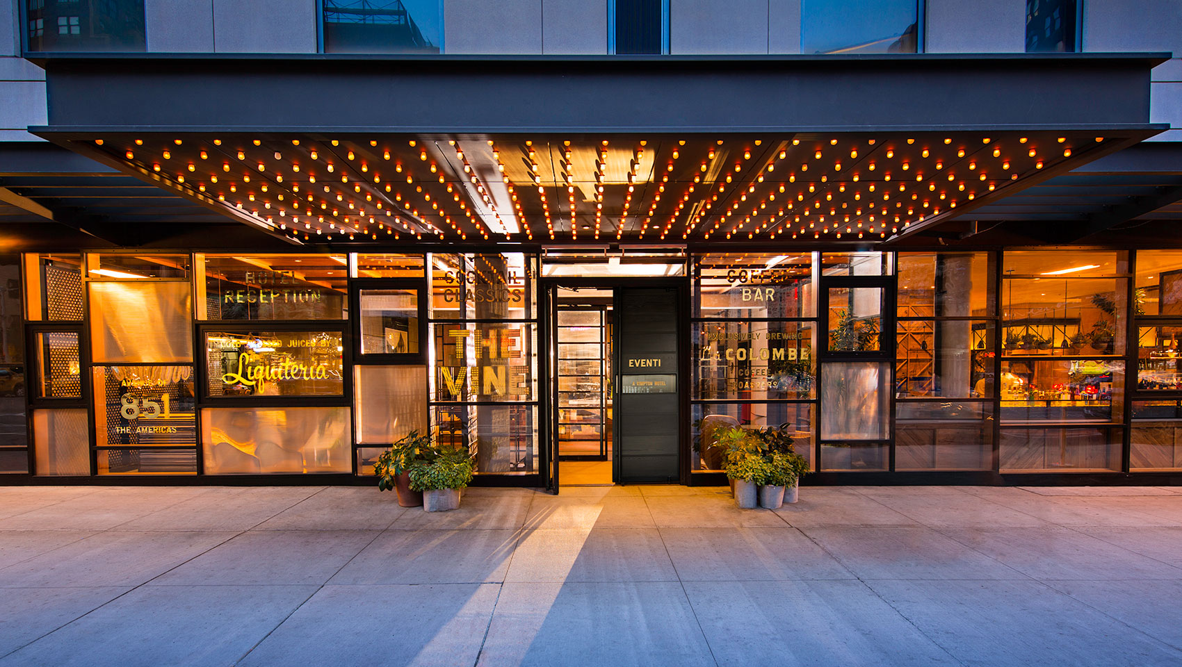Kimpton Hotel Eventi front entrance façade with lighting and glass walls