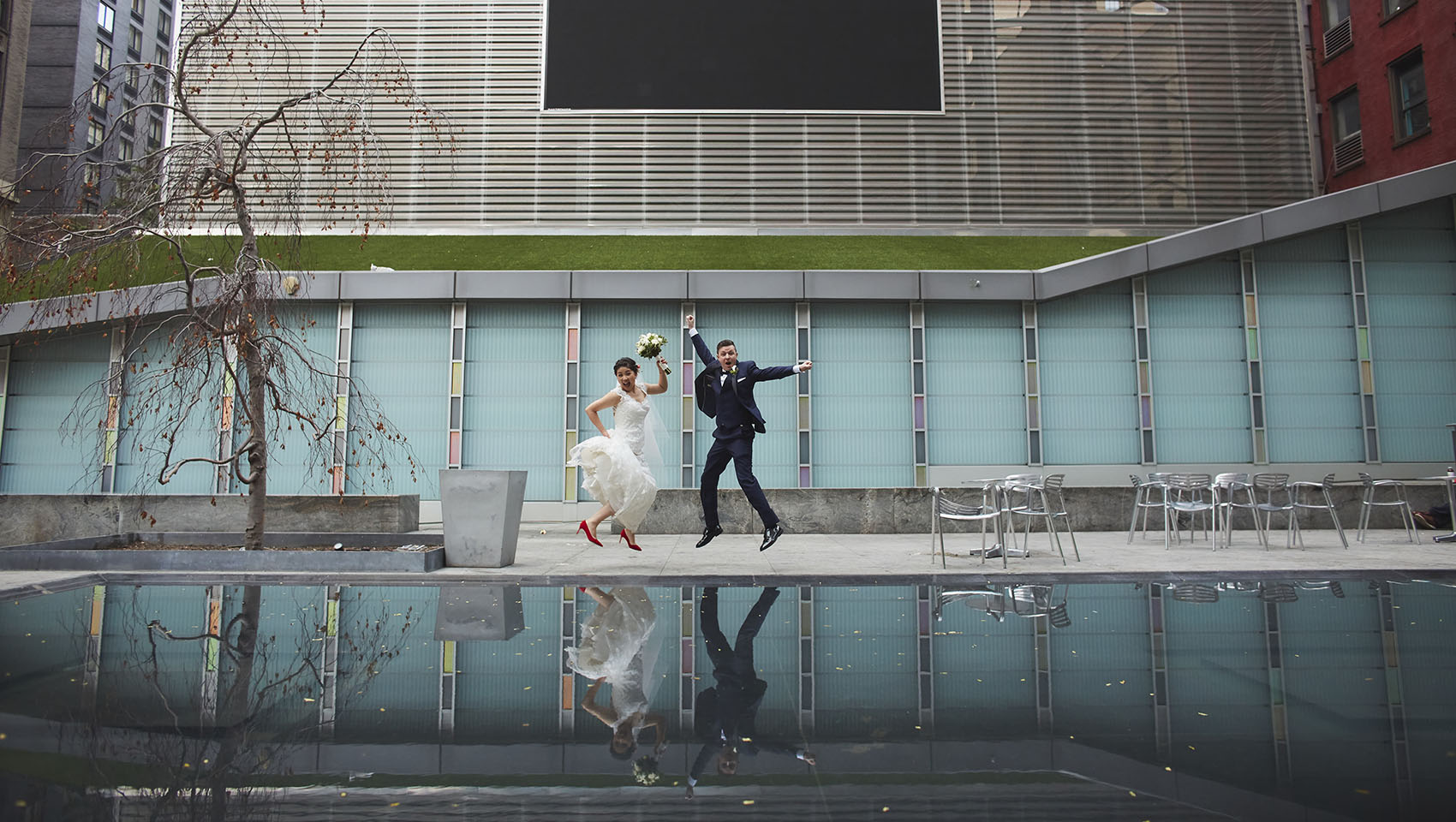 Yoko and Roman jumping in joy at Kimpton Hotel Eventi's Big Screen Plaza