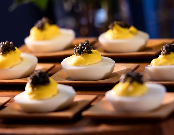 Deviled egg hors d'oeuvre neatly placed in rows