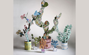 Taylor Mckimens art piece with 3 plants made from paper and wire
