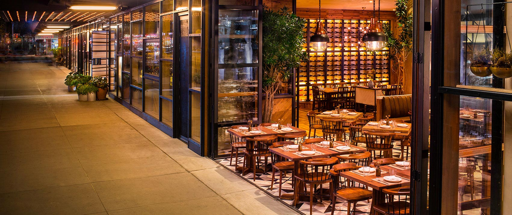 L'Amico restaurant open design with open doors and outdoor seating on sixth avenue
